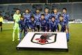 日本のスターティングイレブン。写真:茂木あきら(サッカーダイジェスト写真部)