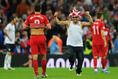 選手の元に一直線!(2014年W杯イングランド対ポーランド) (C)Getty Images